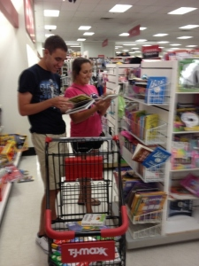 Yahel Volunteer and her brother, picking out books to send to Israel