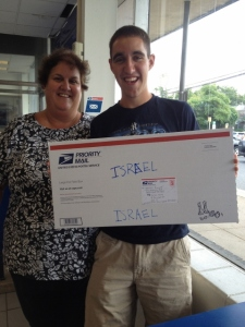 Hannah's mom and brother with the package just before mailing it to Israel.