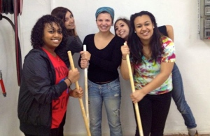 Sarah, center, working in a local youth center in Arad during the trip.